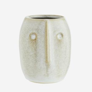 Pot de fleurs avec empreinte de visage
